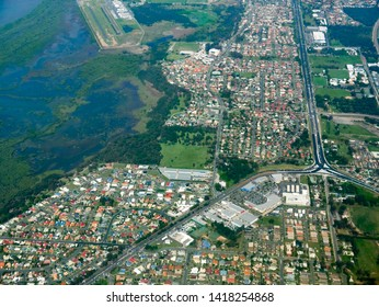 ROTHWELL, QUEENSLAND, AUSTRALIA - NOVEMBER 6, 2017: Mangrove wetlands of the Deception Bay(left) abut residential development in the isthmus of Redcliffe Peninsula, with Anzac Avenue arterial road.