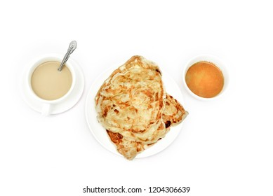 Roti canai with egg on a plate also known as roti cane or roti prata is an Indian-influenced flatbread dish found in several countries in Asia including Malaysia Brunei Indonesia.