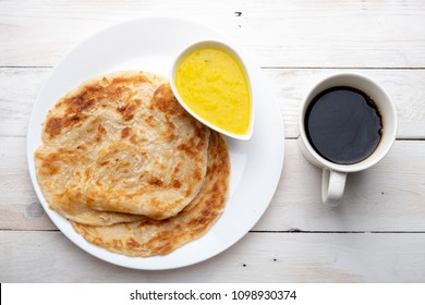 Roti canai or paratha with dhal