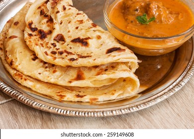 Roti and chicken curry close up selective focus