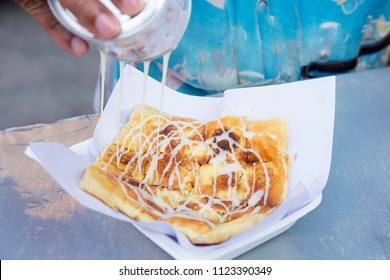 Roti fried pouring with condensed milk / Bangkok street food