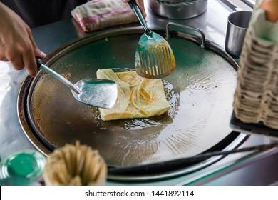 Roti Making, roti thresh flour by roti maker with oil. Indian traditional street food. Thai Pancake Banana And Egg . Thai Street Food and Desserts. Making of roti snack