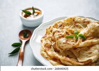 Roti Parata or Roti canai with curry sauce