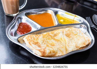Roti prata or canai set with curry, dhal and sambal. Favorite breakfast in Malaysia