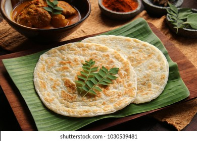 Roti Prata with Chicken Curry. Indian influenced food of flatbread with chicken curry, popular in Singapore and Malaysia.