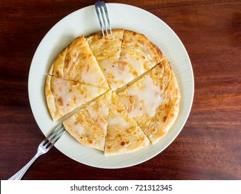 Roti with Sweetend Condensed milk served on table.