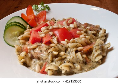 Rotini noodles in a creamy pesto sauce with pine nuts.