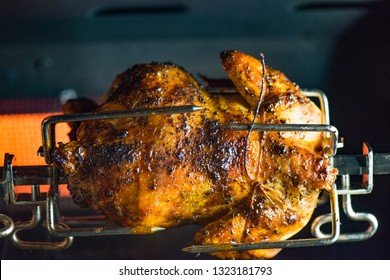 Rotisseri chicken on grill