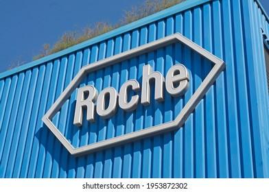 Rotkreuz, Zug, Switzerland - 28th March 2021 : Roche sign in front at the Roche Diagnostics campus in Rotkreuz, Switzerland. F. Hoffmann-La Roche AG is a Swiss multinational healthcare company