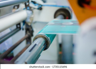 Rotogravure Printing method. It is one of flexible packaging process. Plan film was printed each color thru cylinder. Machine is running in high speed mode. This system is suitable for repeated work.