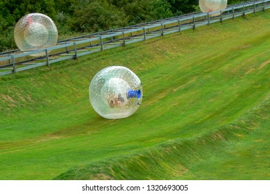 ROTORUA, NEW ZEALAND - 24 DEC 2007: Zorbing is the fun activity of rolling down a hill in a large inflated plastic ball called a zorb.