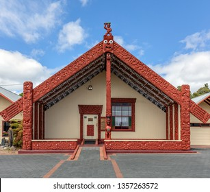 ROTORUA, NEW ZEALAND, FEBRUARY 25, 2019: Ornate Maori meeting house in Whakarewarewa village and Thermal Park. North Island of New Zealand