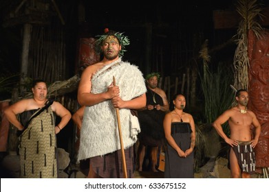 ROTORUA, NZL - APR 25 2017:Maori tribal chief and people in Maori village. Maori are the indigenous people of New Zealand that migrated to New Zealand from Polynesia1000 years ago.
