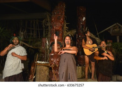 ROTORUA, NZL - APR 25 2017:Maori people sing and dance. Maori are the indigenous people of New Zealand that migrated to New Zealand from Polynesia1000 years ago.