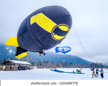 ROTTACH, GERMANY - FEBRUARY 18: blimp (hot air airship) flying at the european alps on feb 18, 2018 in rottach, germany