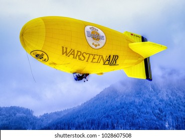 ROTTACH, GERMANY - FEBRUARY 19: blimp (hot air airship) flying at the european alps on feb 19, 2016 in rottach, germany