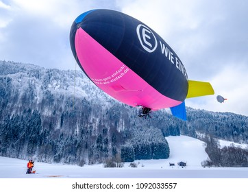 ROTTACH, GERMANY - FEBRUARY 21: blimp (hot air airship) flying at the european alps on feb 21, 2018 in rottach, germany