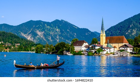 Rottach-Egern, Germany - July 19: boat with passengers in front of the church of Rottach-Egern on July 19, 2016