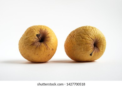 Rotten apples of yellow color with white background