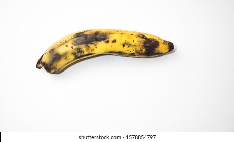 Rotten banana with eco inscription on a white background.