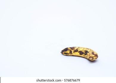 Rotten banana on isolated white background