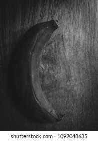 rotten banana on the wood table in black and white and high contrast concept