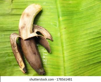 Rotten bananas on a banana leaf