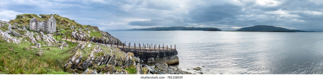 The rotten pier at Craignish point with the Sound of Jura and the Islands of Scarba and Jura in the background, Scotland
