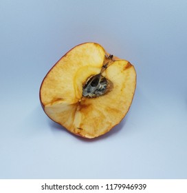 rotten red apple with mold on white background