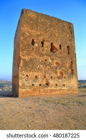 Rotten wall of the ruins of Marinid (Merenid) tombs at sunset, Fes, Morocc
