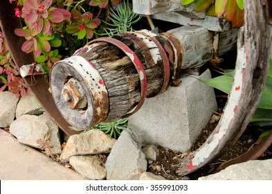 Rotten wooden wheel in Old town, San Diego, hold by rusty metalwork