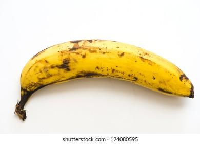 rotten, yellow banana on white background