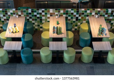 ROTTERDAM, 13 April 2019 - Up down view of three empty table of a restaurant inside the Markthal (Market place in Dutch) building waiting for customer