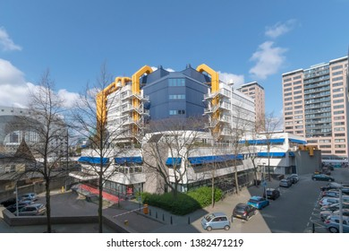 ROTTERDAM, 13 April 2019 - View of the Rotterdam municipality library building nested to the Markthal (Market Hall) under a bright and blue sunny sky, Netherlands
