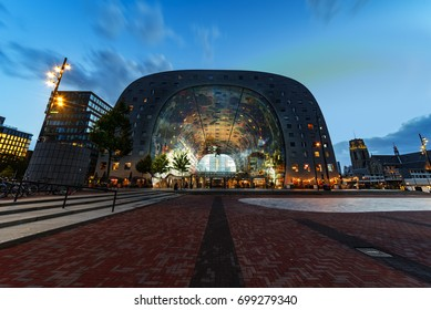ROTTERDAM, 19 August 2017 - Blue hours sunset on the Markthal brick court and modern building where all the locals use to get their meals or their raw food materials, Netherlands