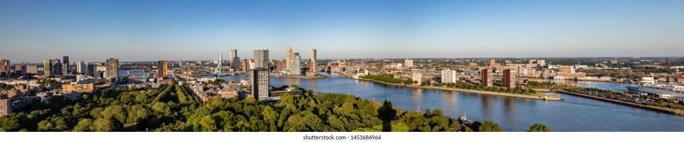 Rotterdam city aerial view. Panorama of Rotterdam city, river Maas and Erasmus bridge, sunny day. Netherlands, banner