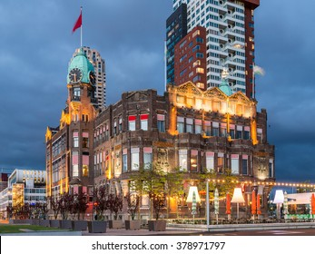Rotterdam City, Hotel New York, Famous Hotel Former Holland America Cruiseline Cruise to New York Old Office building Architecture Illuminated at Night on Kop van Zuid, Netherlands.