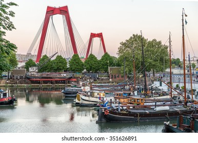Rotterdam City, Oude Haven oldest part of the harbour, historic ship yard dock, Old Ship, Openlucht Binnenvaart Museum, Haringvliet and the Willemsbrug bridge at Dusk in Summer, Netherlands