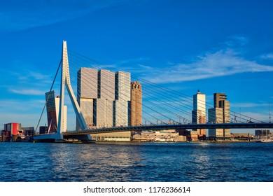 Rotterdam cityscape with Erasmus bridge over Nieuwe Maas river on sunset. Netherlands
