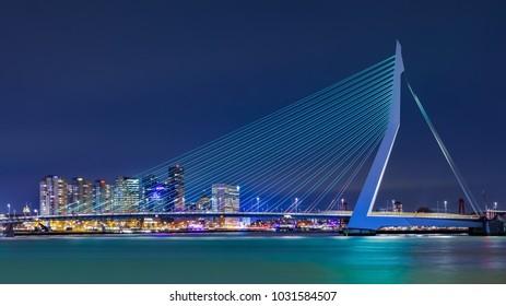 ROTTERDAM- FEBRUARY 14, 2018. The Erasmus Bridge at night. The 284m long bridge was designed by Ben van Berkel (UNStudio) and connects Kop van Zuid with the city center. It has the nick name The Swan.