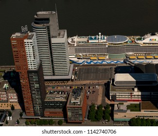 Rotterdam, Holland, 28 June 2018. Aerial photo of skyscraper Montevideo at the Maasharbor. Next to it World Port Center and a huge cruiseship of AIDA.