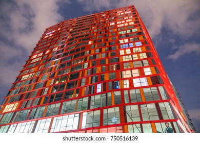 ROTTERDAM, HOLLAND -AUGUST 22; Bright Calypso skyscraper apartment building stunning design, patterned exterior with colored window lights against night sky August 22, 2017 Rotterdam Holland