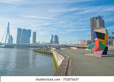 ROTTERDAM, HOLLAND -AUGUST 22; colored cubic sculpture Marathon Image on waterfront with city's stunning modern architectural buildings forming backdrop August 22, 2017 Rotterdam Holland