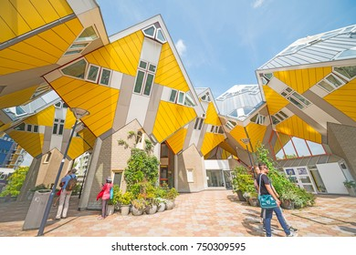 ROTTERDAM, HOLLAND - AUGUST 22; Cube houses of Rotterdam, quirky bright yellow angular cube shape apartment block few  tourists showing interest in the unusual August 22, 2017 Rotterdam, Holland
