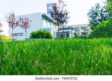 ROTTERDAM, HOLLAND- AUGUST 23; Green lawn in selective focus leading to historic 1930's residence known as Sonneveldt House in original art deco style as a museum August 23, 2017 Rotterdam, Holland