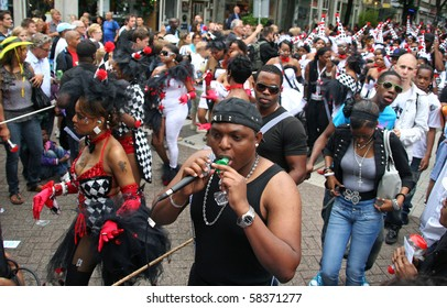 ROTTERDAM, HOLLAND - JULY 31: Party people in the parade of the annual Summer Carnival in Rotterdam on July 31, 2010 in Rotterdam, Holland
