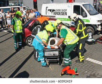 ROTTERDAM, HOLLAND - SEPTEMBER 5: Demonstration of handling of car crash victim by medics at the annual World Harbor Days in Rotterdam, Holland on September 5, 2010