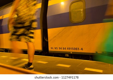Rotterdam, Netherlands, 04-07-2018: A NS train (Dutch train company) at Rotterdam Blaak with people walking to the train