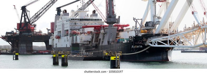 ROTTERDAM, THE NETHERLANDS - 14 APRIL : The 'Audacia'; a 225m deep-sea pipe-laying vessel and the 'Balder' (back) one of the largest deepwater construction vessels in Rotterdam on April 14, 2012