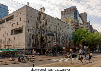 Rotterdam, Netherlands - 27 May:  a group of people walking in front of a ABN AMRO building at Rotterdam on 27 May 2017. Rotterdam is a major port city in the Dutch province of South Holland